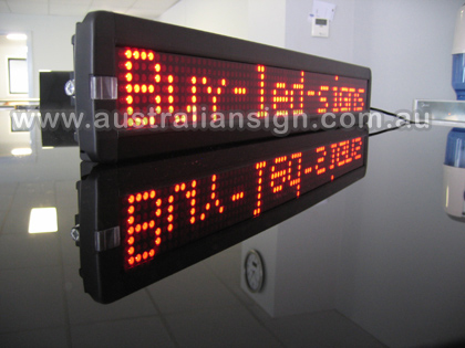 What a great photo, the led sign is on the glass bench reflecting the led light